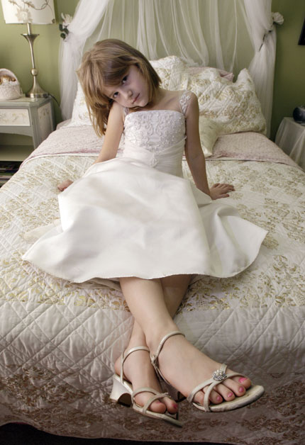 Little girls getting into high heels