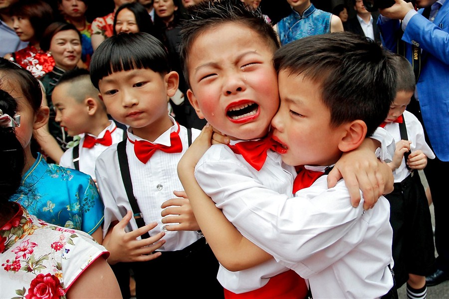 4153662016 Children say a tearful farewell during their first ever graduation ceremony